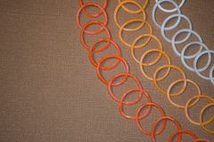 Rubber bands. Fall colored rubber bands on a textured background Stock Photo