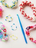 Rubber bands and hook. Close view of loom bands and blue hook Royalty Free Stock Image