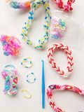 Rubber bands and hook. Close view of loom bands and blue hook and plastic clips Stock Image