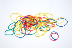 Rubber bands. A lot of colorful rubber bands over white Stock Image