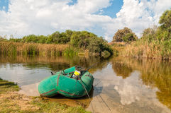 Rubber boat on the lake Stock Photo
