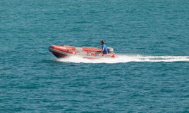 Rubber boat in the ocean Royalty Free Stock Image