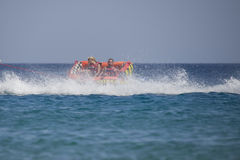 Rubber boat tipping over in the red sea Stock Photo