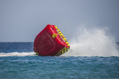 Rubber boat tipping over in the red sea Stock Image