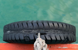 Rubber beside boats. Intended for cushioning the port Royalty Free Stock Photo
