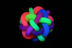 Rubber boll under svart ljus Arkivbild