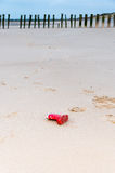 Rubber boot on the beach Royalty Free Stock Photo
