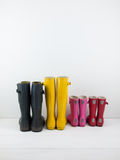 Rubber boots against a white wall Royalty Free Stock Photo