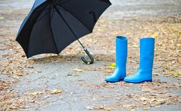 Rubber Boots And Umbrella Stock Photography