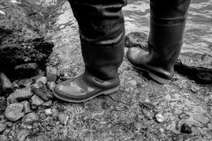 Rubber boots, aquarell painted photo, black and white stock photo