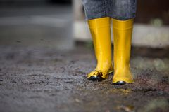 Free Rubber Boots Are Standing In A Dirty Puddle Stock Photos - 53512383