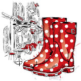 Rubber boots on a background of a city street. Fashion & Style Royalty Free Stock Photos