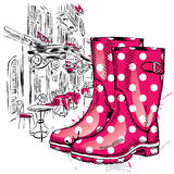 Rubber boots on a background of a city street. Fashion & Style Stock Photos