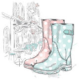 Rubber boots on a background of a city street. Fashion & Style Royalty Free Stock Photo