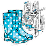 Rubber boots on a background of a city street. Fashion & Style Stock Images