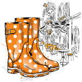 Rubber boots on a background of a city street. Fashion & Style Stock Photo