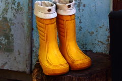 Rubber boots for children. Children's rubber boots are orange to walk through puddles Stock Photos