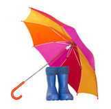 Rubber boots and a colorful umbrella Royalty Free Stock Images