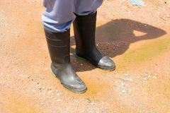 Rubber boots at a construction. Stock Photography