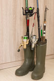 Rubber boots and fishing equipment Royalty Free Stock Image