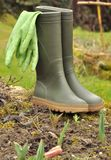 Rubber boots in a garden Royalty Free Stock Image