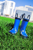 Rubber boots on a grass Royalty Free Stock Photo