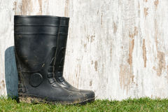 Rubber boots on the grass Stock Photos