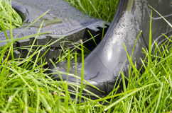 Rubber boots on the grass Stock Photography