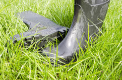 Rubber boots on the grass Stock Photo