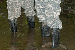 Rubber boots in the mud Stock Photography