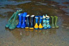 Rubber boots in rain stock images