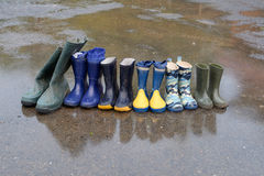 Rubber boots in rain Royalty Free Stock Images