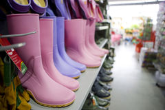 Rubber boots on shelf in shop Stock Photography
