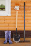 Rubber boots with shovel and rake Royalty Free Stock Photography