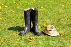 Rubber boots with straw Royalty Free Stock Photos