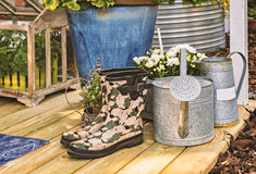 Rubber boots on terrace Royalty Free Stock Photography