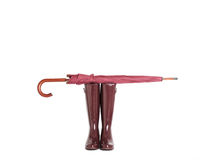 Rubber boots and umbrella stick color Marsala on isolated backgr Royalty Free Stock Photography