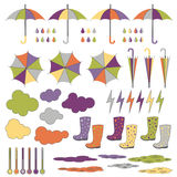 Rubber boots, umbrellas, rain. Vector set. Royalty Free Stock Images