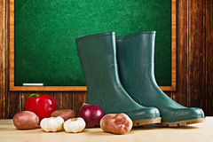 Rubber boots and various vegetable Stock Photo
