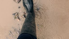 Rubber Boots Walking Through Water stock video footage