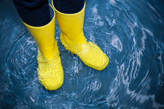 Rubber boots in the water stock images