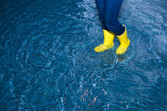 Rubber boots in the water Stock Image