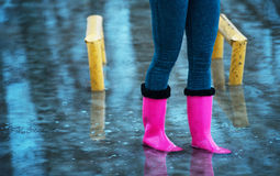Rubber boots in the water Royalty Free Stock Images
