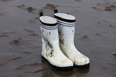 Rubber boots, white and dirty Royalty Free Stock Photography