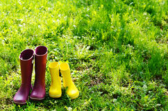 Rubber boots for woman and child in summer garden Stock Photo