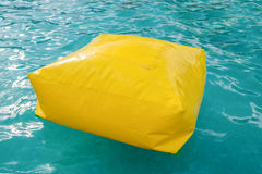 Rubber box air bag yellow on pool Stock Image