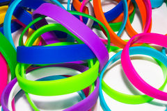 Rubber bracelets. Silicone fashion round social bracelet wear. white background Stock Photo