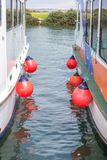 Rubber bumpers for boats of ships. On river. Royalty Free Stock Images