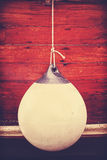 Rubber buoy, vintage toned concept photo. Royalty Free Stock Photo