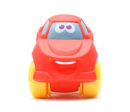 Rubber car. Smiling red rubber toy car with yellow wheels isolated on white background front view Royalty Free Stock Photo